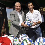 Krikor Djabourian and Henrikh Mkhitaryan posing with the signed footballs for Charity