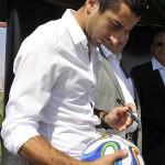 Henrikh Mkhitaryan signing the footballs