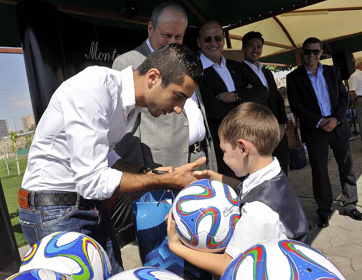 Henrikh Mkhitaryan shaking hands with his fan